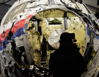 PHOTOS: Wreckage of Flight MH17 presented to the press