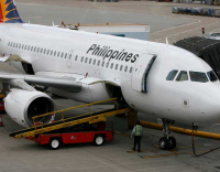 Tricycle couple 'blown away' by PAL plane landing