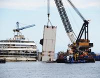 Costa Concordia nears end of final voyage to scrap yard