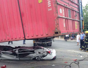Pair cheat death as shipping container flattens car