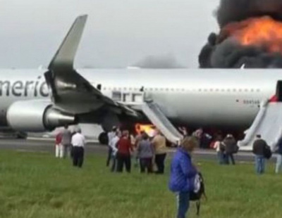 American Airlines jet bursts in flames during take-off