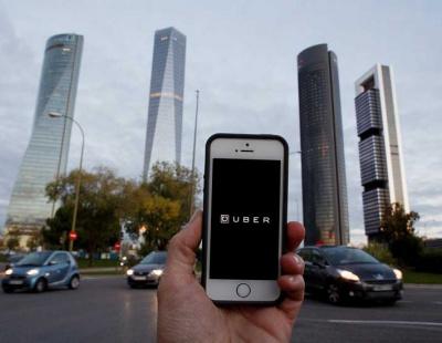 Uber shares slide after posting quarterly loss of $5.2bn