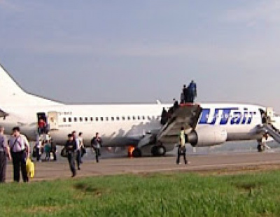 WATCH: B737 catches fire, passengers jump from wing