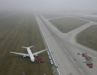 Airliner shreds tires in near collision on runway