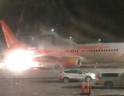 Fire erupts as passenger jets collide on runway