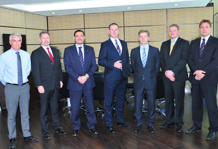 Executives from Abu Dhabi Ports and Konecranes.