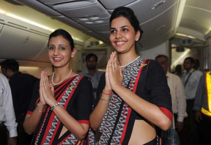 Air India flight attendants (RAVEENDRAN/AFP/GettyImages)