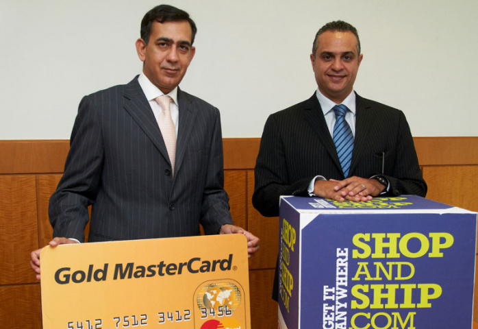 Raghu Malhotra, general manager, Middle East, MasterCard Worldwide (left) and Hussein Hachem, CEO for Middle East & Africa, Aramex (right).