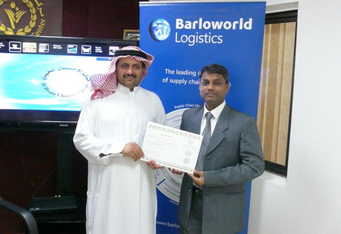 Sanjay More from Barloworld Logistics with Abdullah M. Aljaadi from Al Ihsan Charity Centre