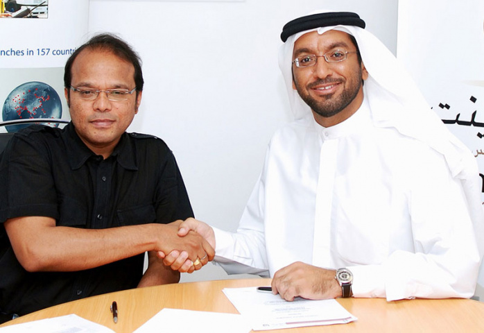 Hellmann Middle East CEO, Madhav Kurup, with CPL chairman, Saleh Lootah
