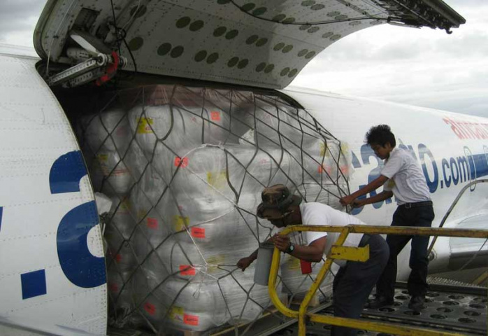 Workers unload aid from a Chapman Freeborn-chartered DC-8 in Rangoon last year.