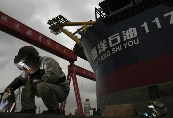 Man at work in Chinese shipbuilding yard