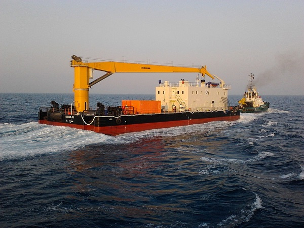 Damen Shipyards Sharjah delivers two barges, a Crane Barge 4920 and an Anti-Pollution Barge 2405, to Middle East contractor BINCO.