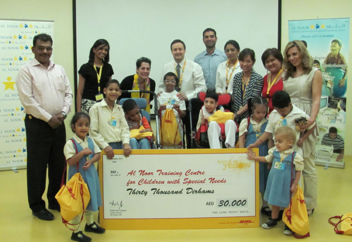 As part of DHL's CSR initiative, staff donated AED30000 to the Al Noor Centre for Children with Special Needs.