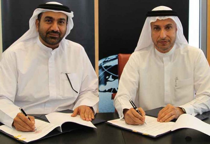 Dr. Mohammed Al Zarooni, Director General of DAFZA and Hesham Abdulla Al Qassim, CEO, Wasl Asset Management Group.