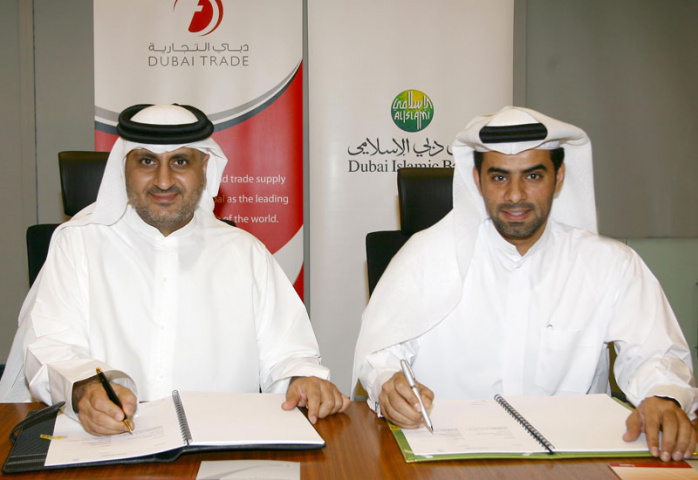 Mahmood Al Bastaki, director, Dubai trade, and Musabbah Al Qaizi, head of electronic banking, DIB, signing the agreement.