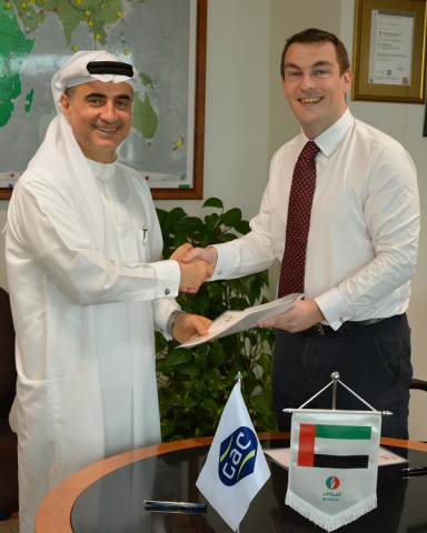 Mohammed El Sadek, Director, ENOC Lubricants Marketing signs the sales and distribution agreement with Nicholas Browne, GAC Bunker Fuels Director