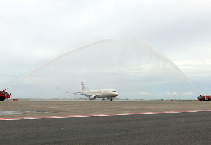 The inaugural flight was welcomed with a traditional water cannon salute.