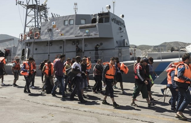 Middle Eastern crew of Libya bound cargo ship arrested off Greece after weapons stash found among cargo.