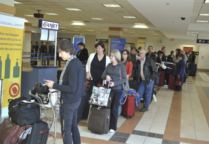 Passengers wait in line at Halifax (George Pimentel/Getty Images).