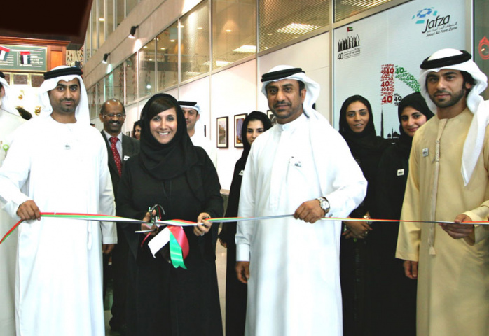 Salma Hareb, CEO, Economic Zones World, cuts the ribbon for National Day celebrations.