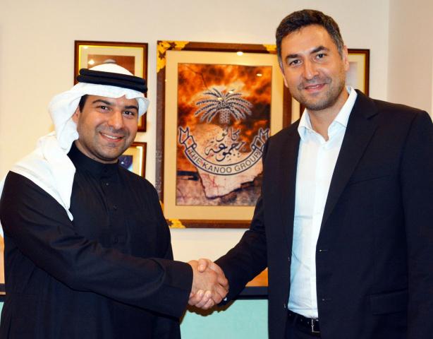 Fahad Fawzi Kanoo representative Yusuf Bin Ahmed Kanoo Group, and Idris al-Rifai, co-founder of Fetchr (right).
