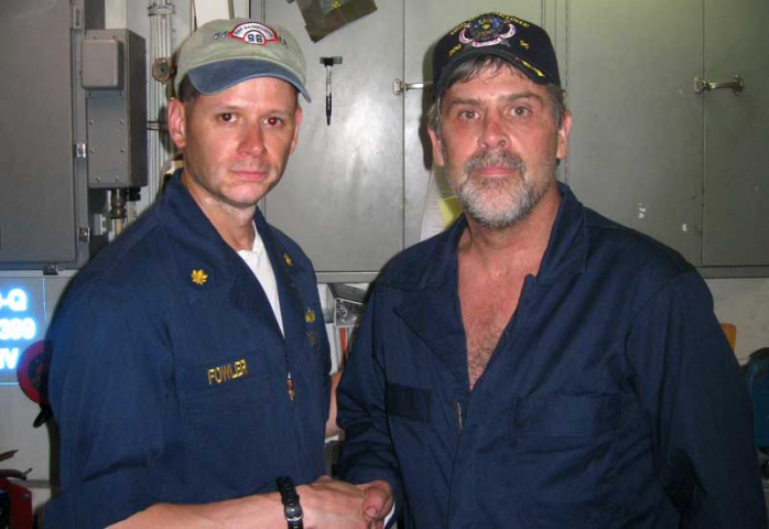 Maersk Alabama captain Richard Phillips shakes hands with the commander of the USS Bainbridge. Courtesy of AFP/Getty.