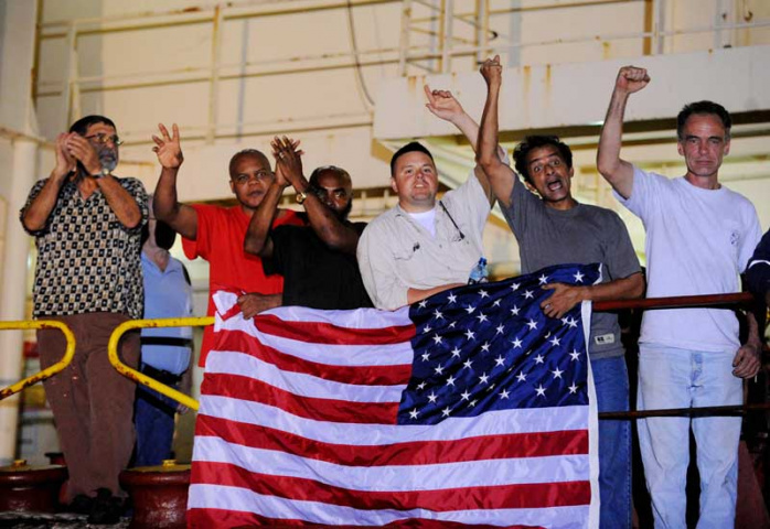 Crewmen from the Maersk Alabama celebrate after hearing of the release of their captain from Somalian pirates. Courtesy of AFP/Getty.