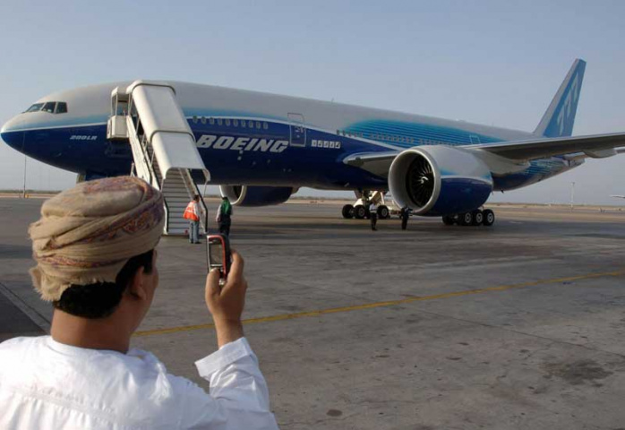 An Omani man takes a picture of the Boeing777 worldliner at Muscat International Airport (MOHAMMED MAHJOUB/AFP/Getty Images)