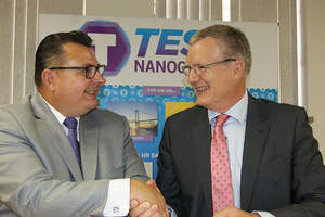 Todd Hawkins (left), president and CEO of Tesla NanoCoatings, and Niels Uhrbrand (right), senior consultant of Norwegian Drilling Group, celebrate sig