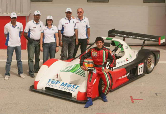 Members of the TMFS team pose with young Emirati driving sensation Sultan Mahboubi.