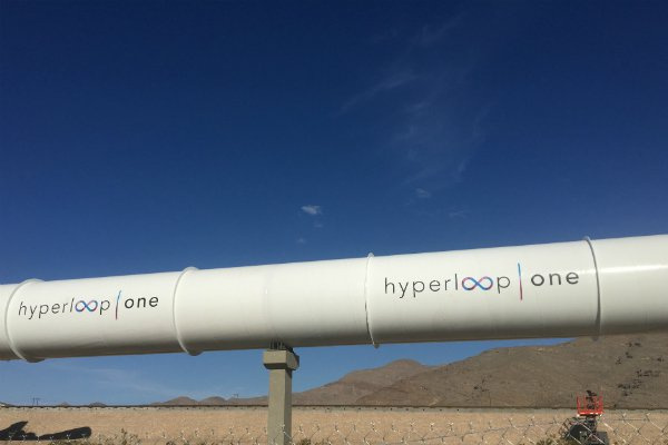 The plan shows the Hyperloop connecting three airports in the UAE - Abu Dhabi Airport, Al Maktoum Airport and Dubai Airport - with future cargo port connections for Khailfa Port and Jebel Ali Port.