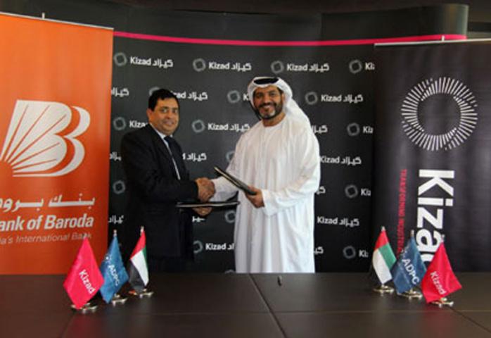 Ashok K.Gupta and Khaled Salmeen signing the agreement on behalf of Bank of Baroda and Kizad.