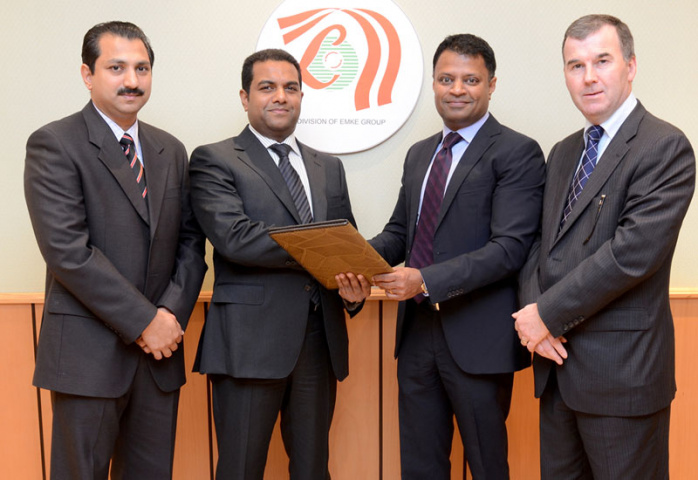 Lulu Hypermarket and Gulf Warehousing Company executives exchanging contract documents