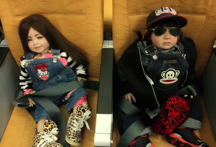 The dolls with 'supernatural powers' aboard the aircraft.