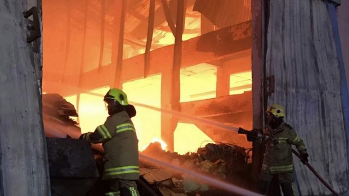 The blaze broke out in a furniture warehouse in the Al Jarf area and quickly spread to three other warehouses.