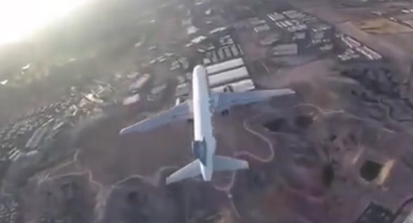 Police are investigating after video footage emerged on YouTube of a drone flying extremely close to a passenger jet thats about to land.