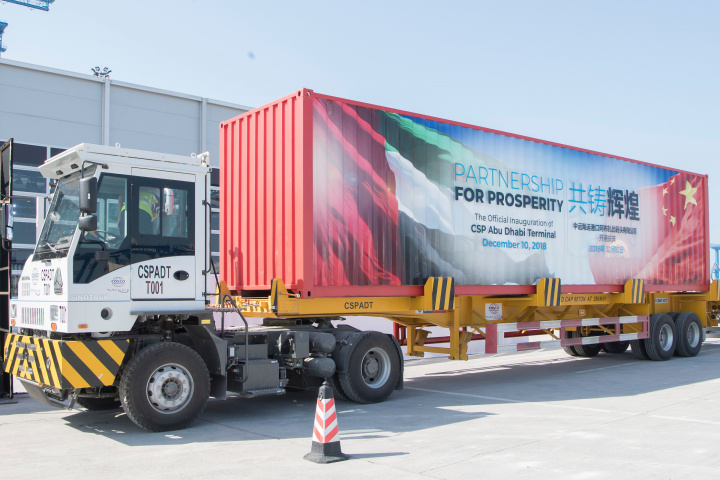 ABU DHABI UNITED ARAB EMIRATES  December 10 2018 A truck displays a sign during the opening of the CSP Abu Dhabi Terminal at Khalifa Port Saeed Al Neyadi  Ministry of Presidential Affairs