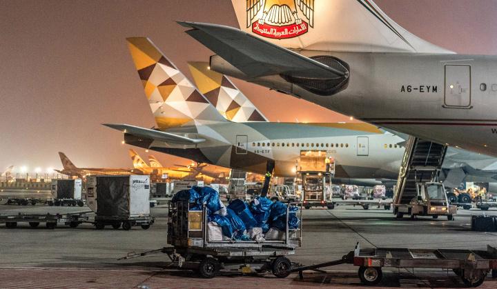 Etihad Boeing 777 passenger aircraft parked on the apron of Abu Dhabi International Airport.