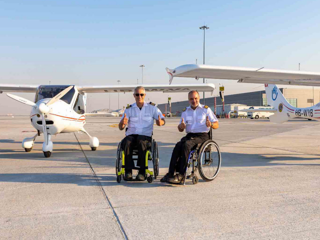 A file photo of pilots Mike Lomberg (left) and Guillaume Feral following their arrival at Dubai World Central (DWC).