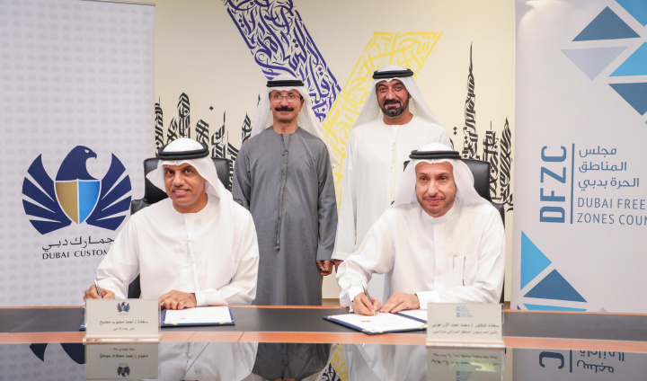 Ahmed Bin Saeed witnessing Dr Zarooni and Ahmad Musabbeh signing the MoU.