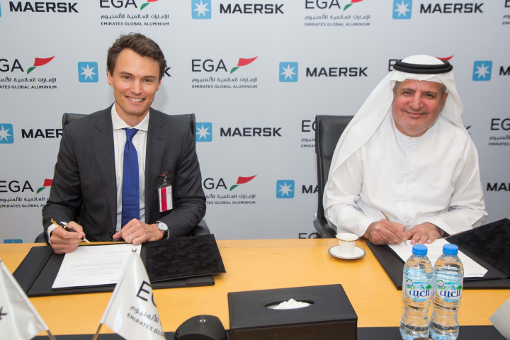Christopher Cook, managing director for Maersk in UAE, Oman and Qatar and Walid Al Attar, EGA's chief marketing officer, sign the agreement.