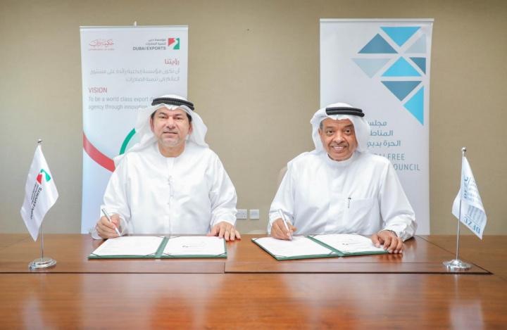 Dr. Juma Al Matrooshi and Saed Alawadi signing the MoU